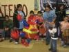 Children Smash the Neoliberal Piñata